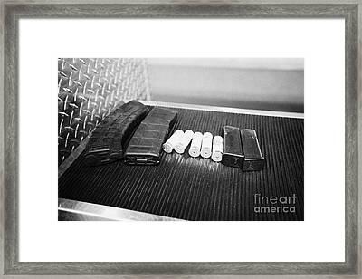 Various Rifle Assault Weapon Pistol Magazines And Shotgun Shells At A Gun Range In Las Vegas Nevada  Framed Print by Joe Fox