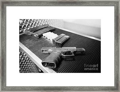 Various Rifle Assault Weapon Pistol Magazines And Shotgun Shells With 9mm Glock Handgun At A Gun Ran Framed Print by Joe Fox