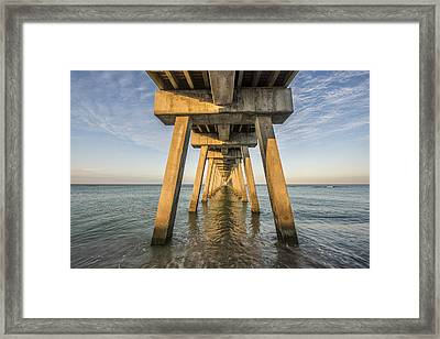 Venice Below The Pier Framed Print by Jon Glaser