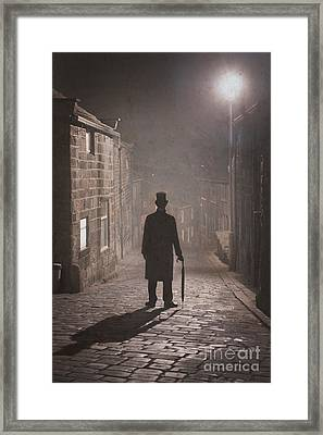 Victorian Man With Top Hat On A Cobbled Street At Night In Fog Framed Print by Lee Avison
