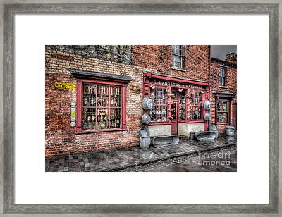 Victorian Stores England Framed Print by Adrian Evans