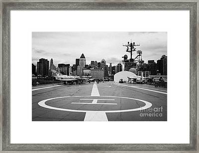 view of manhattan from the rear helicopter pad on the flight deck USS Intrepid  Framed Print by Joe Fox