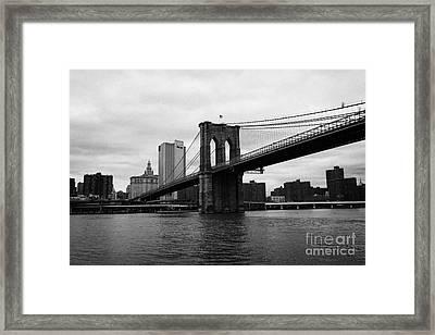 View Of New York From Beneath The Brooklyn Bridge New York Framed Print by Joe Fox