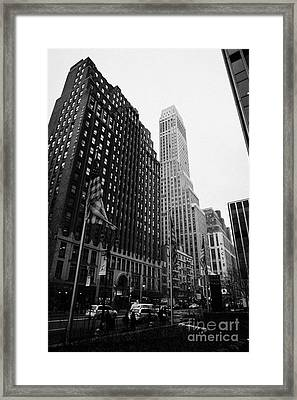 view of pennsylvania bldg nelson tower and US flags flying on 34th street from 1 penn plaza Framed Print by Joe Fox