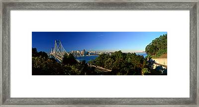 View Of The Bay Bridge And Downtown San Framed Print by Panoramic Images