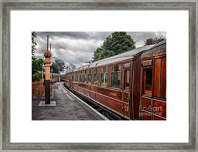 Vintage Carriages Framed Print by Adrian Evans