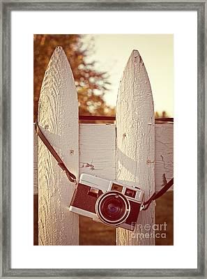 Vintage Film Camera On Picket Fence Framed Print by Edward Fielding