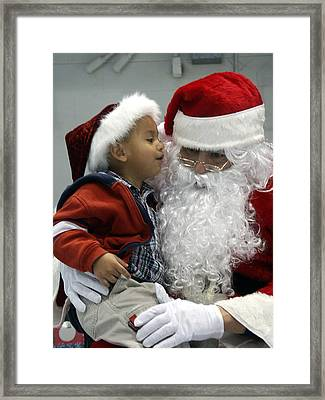 Visiting Santa Clause Framed Print by Unknown