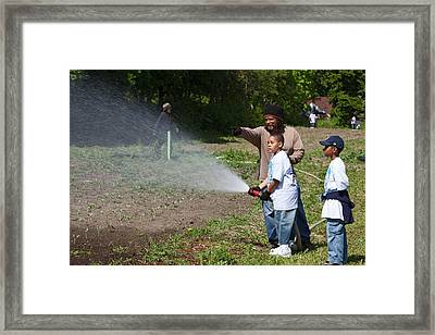 Volunteers At An Urban Farm Framed Print by Jim West