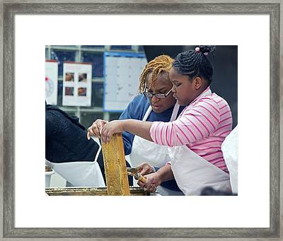 Volunteers Uncapping Honeycomb Framed Print by Jim West