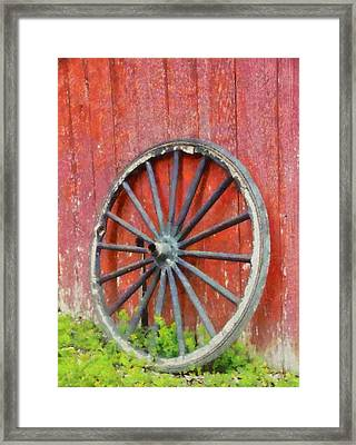Wagon Wheel On Red Barn Framed Print by Dan Sproul