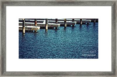 Waiting For Summer - Boat Slips Framed Print by Mary Machare