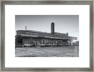 Waiting For The Bus II Framed Print by Clarence Holmes