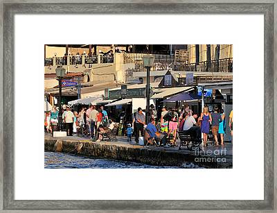 Walking In The Old Port Of Chania Framed Print by George Atsametakis