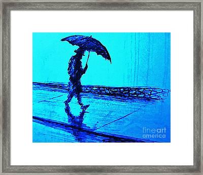 Walking In The Rain Framed Print by John Malone