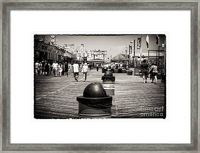 Walking The Boardwalk Framed Print by John Rizzuto