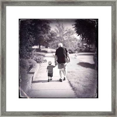 Walking With Grandpa Framed Print by Natasha Marco