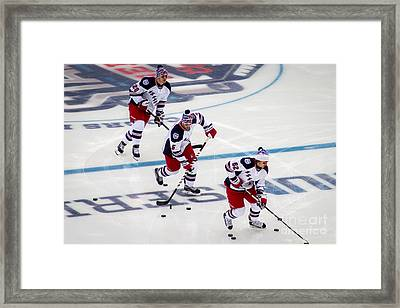 Warming Up Framed Print by David Rucker