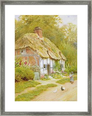 Watching The Ducks  Framed Print by Arthur Claude Strachan