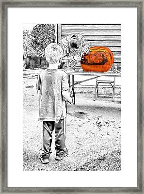 Watching The Pumpkin Carver Framed Print by John Haldane