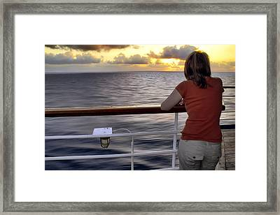 Watching The Sunrise At Sea Framed Print by Jason Politte