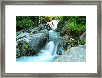 Waterfall Near Paradise Framed Print by Jeff Swan