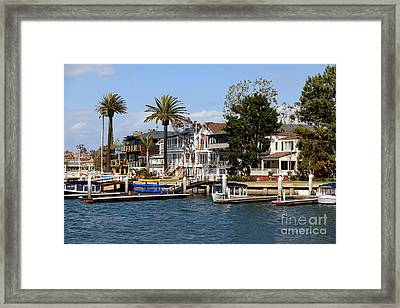 Waterfront Luxury Homes In Orange County California Framed Print by Paul Velgos