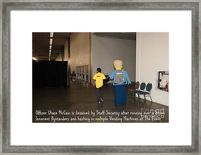 Weird Police Blotter Officer Chase Mccain Is Detained By Staff Security At The Event 5d25200 Framed Print by Wingsdomain Art and Photography
