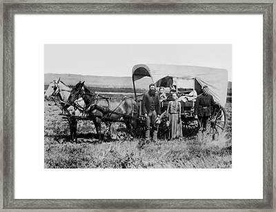 Westward Family In Covered Wagon C. 1886 Framed Print by Daniel Hagerman