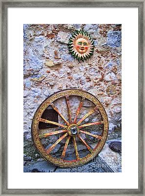 Wheel And Sun In Taromina Sicily Framed Print by David Smith