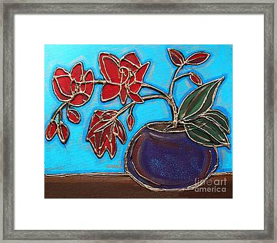 Whimsy Red Orchid Framed Print by Cynthia Snyder
