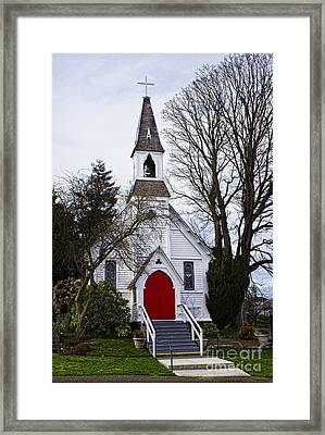 White Church With Red Door Framed Print by Elena Nosyreva