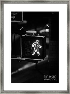 White Man Pedestrian Walk Sign Illuminated At Night New York City Usa Framed Print by Joe Fox