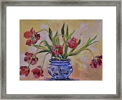 Wilting Tulips Framed Print by Donna Tuten