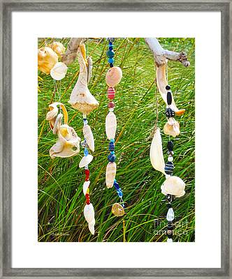 Wind Chimes At The Beach Framed Print by Michelle Wiarda