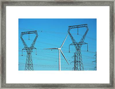 Wind Turbine And Electricity Pylons Framed Print by Jim West