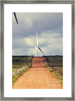 Wind Turbine And Red Dirt Road Framed Print by Colin and Linda McKie