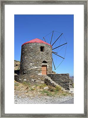 Windmill In Oia Town Framed Print by George Atsametakis