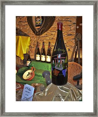 Wine Bottle On Display Framed Print by Allen Sheffield