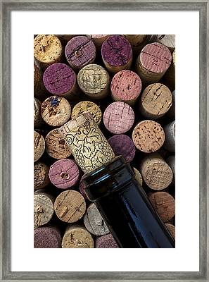 Wine Bottle With Corks Framed Print by Garry Gay