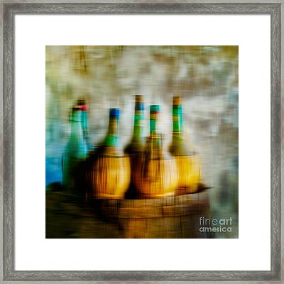 Wine On A Barrel  Framed Print by Emilio Lovisa