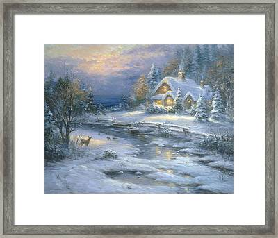Winter Cottage Framed Print by Ghambaro