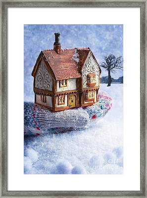 Winter Cottage In Gloved Hand Framed Print by Amanda Elwell