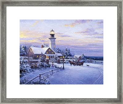 Winter Lighthouse Framed Print by Ghambaro