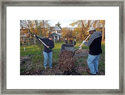 Winter Mulching In A Community Garden Framed Print by Jim West