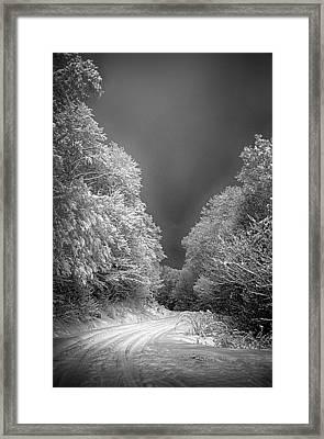 Winter Road Framed Print by John Haldane