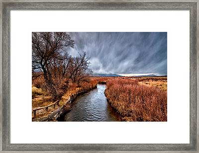Winter Storm Over Owens River Framed Print by Cat Connor