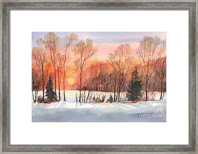 A Winter Sunset Serenade Framed Print by Carol Wisniewski