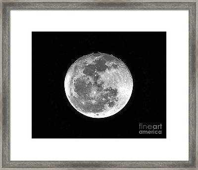 Man In The Moon Framed Print featuring the photograph Wolf Moon Waning by Al Powell Photography USA