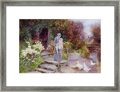 Woman And Child In A Cottage Garden Framed Print by Florence Agnes Mackay